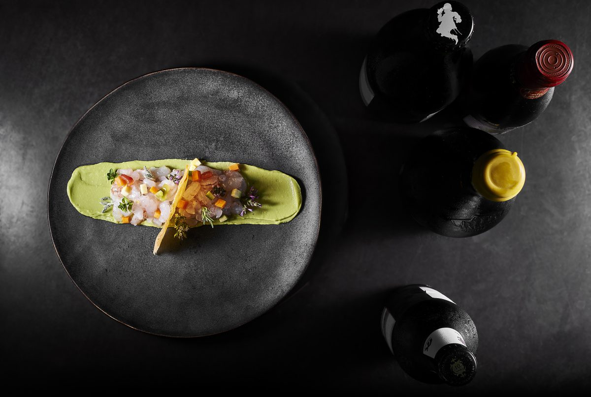 Tartare of red shrimps: tartare of prawns, fried pumpkin flower stuffed, avocado cream, crispy pastry, buffalo mozzarella
